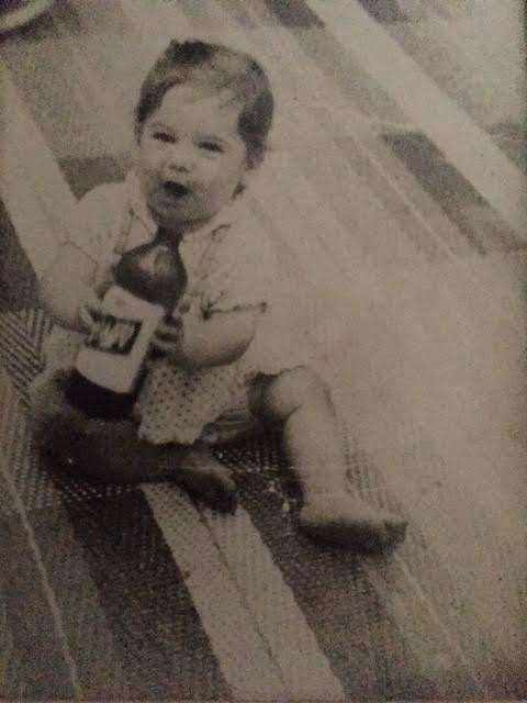 baby with a beer bottle