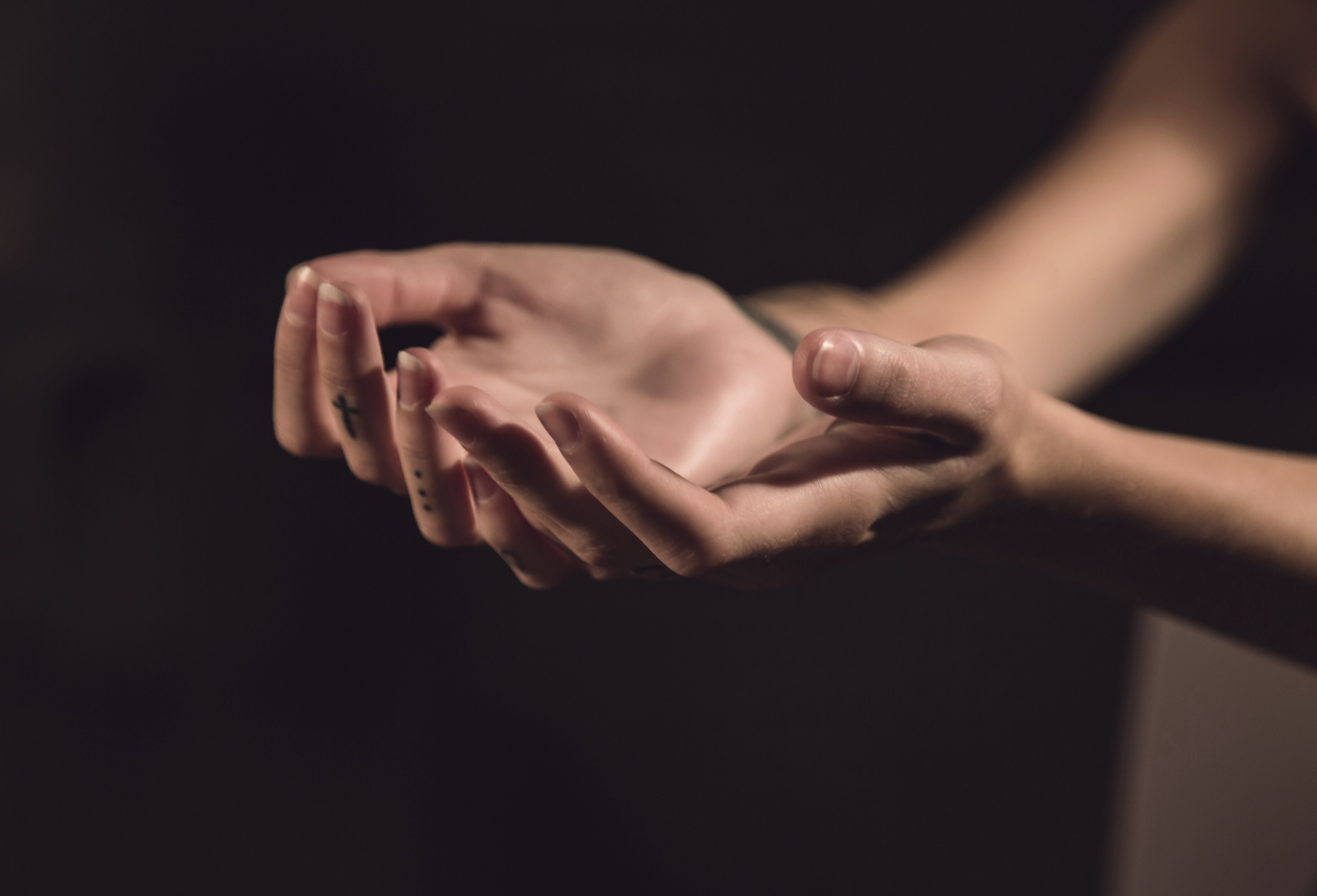 Two hands held out to receive something