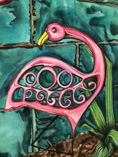 pink flamingo lawn ornament against a green stone wall with iris leaves and dirt