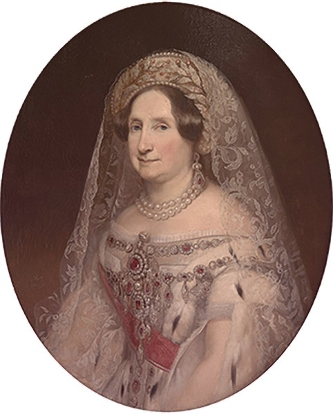 Anna wearing Russian court dress with a lace veil, off-the-shoulder dress, and a ruby and diamond parure.