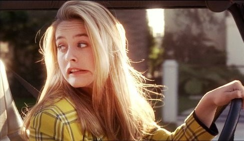 Cher from Clueless making a face after hitting a car