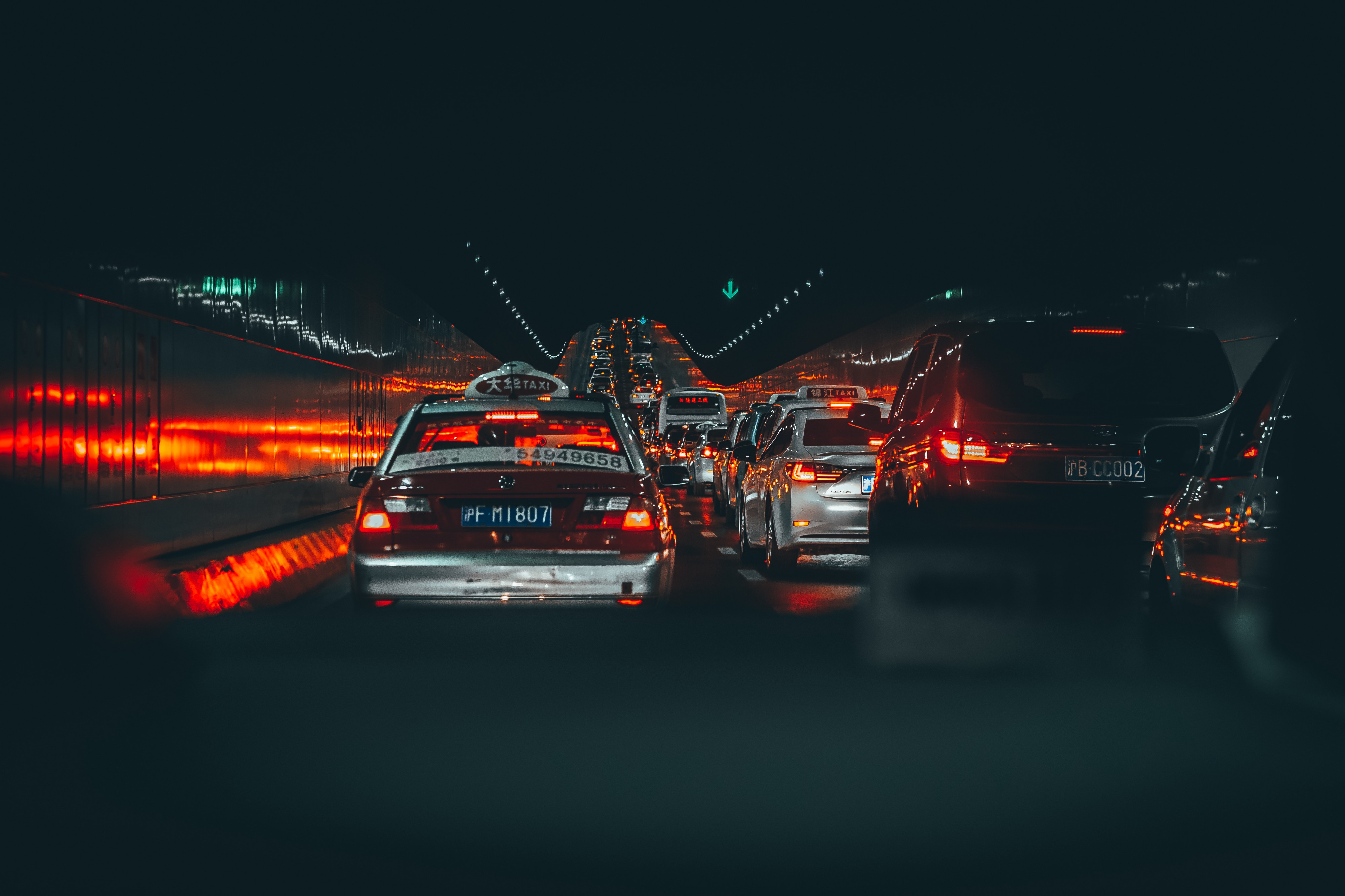 Cars ligned up in a dark tunnel