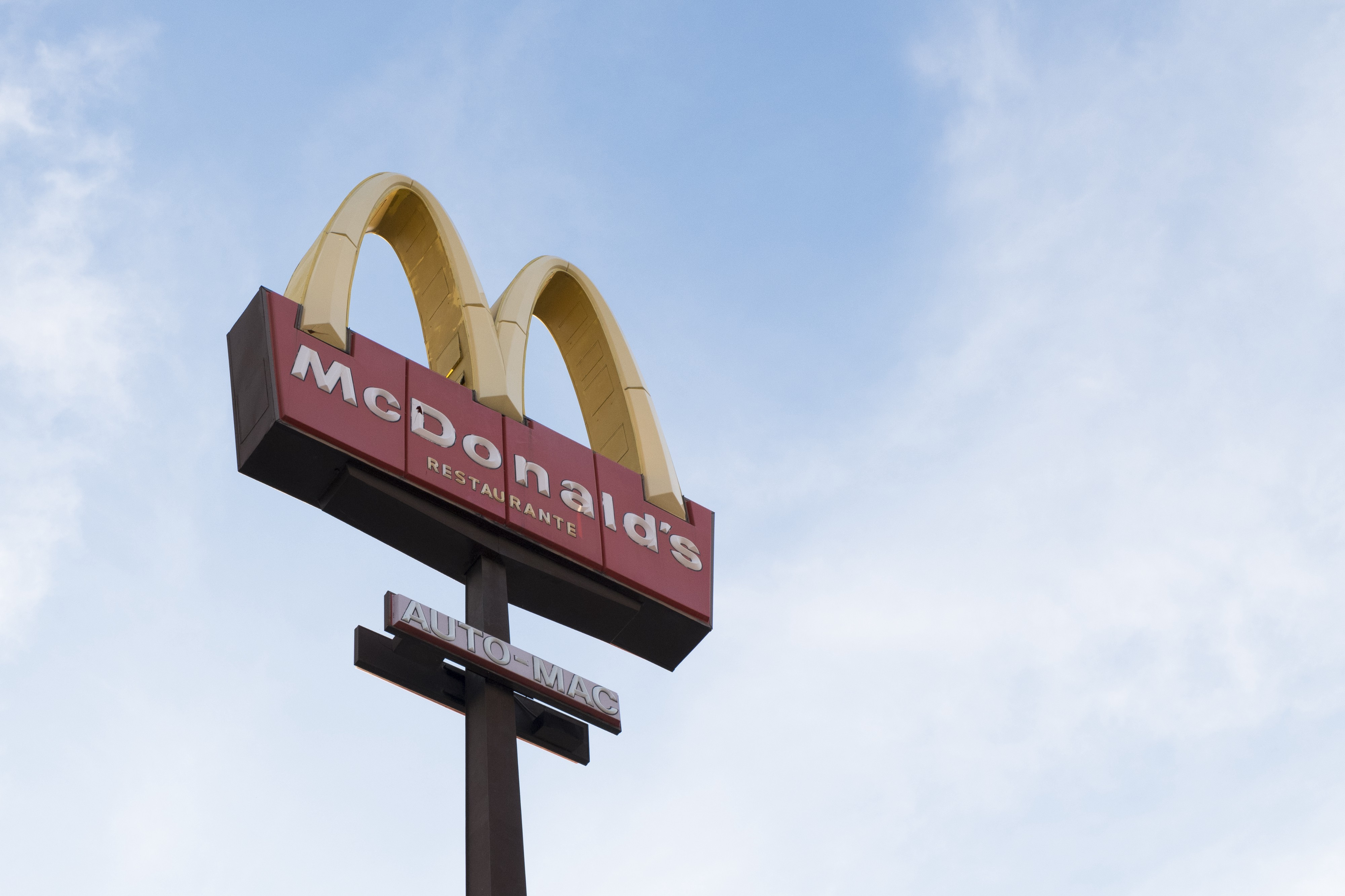 Looking up at McDonald's Golden Arches.
