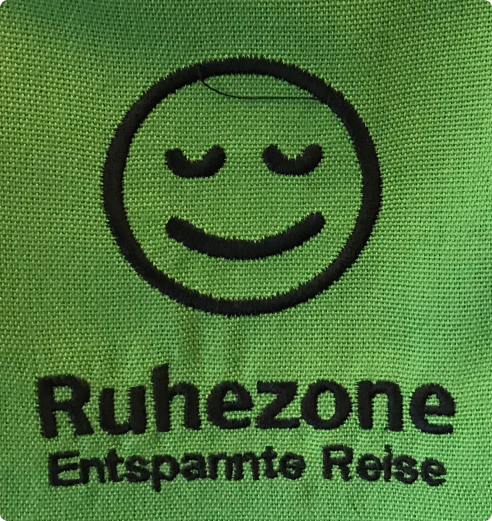 Calm smiley face icon for the quiet zone on the train.