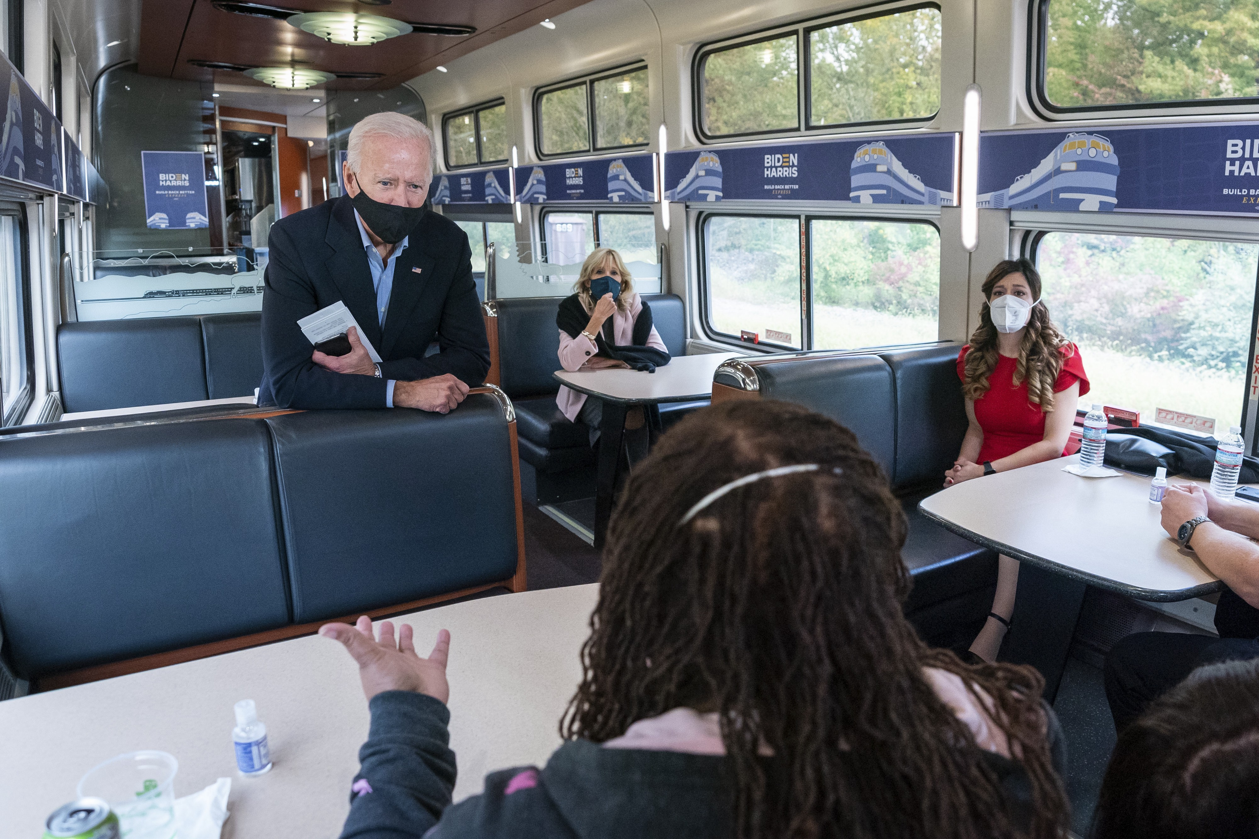 Joe Biden talks to campaign staffers on an Amtrak train in Cleveland, OH during his Build Back Better Express Tour.