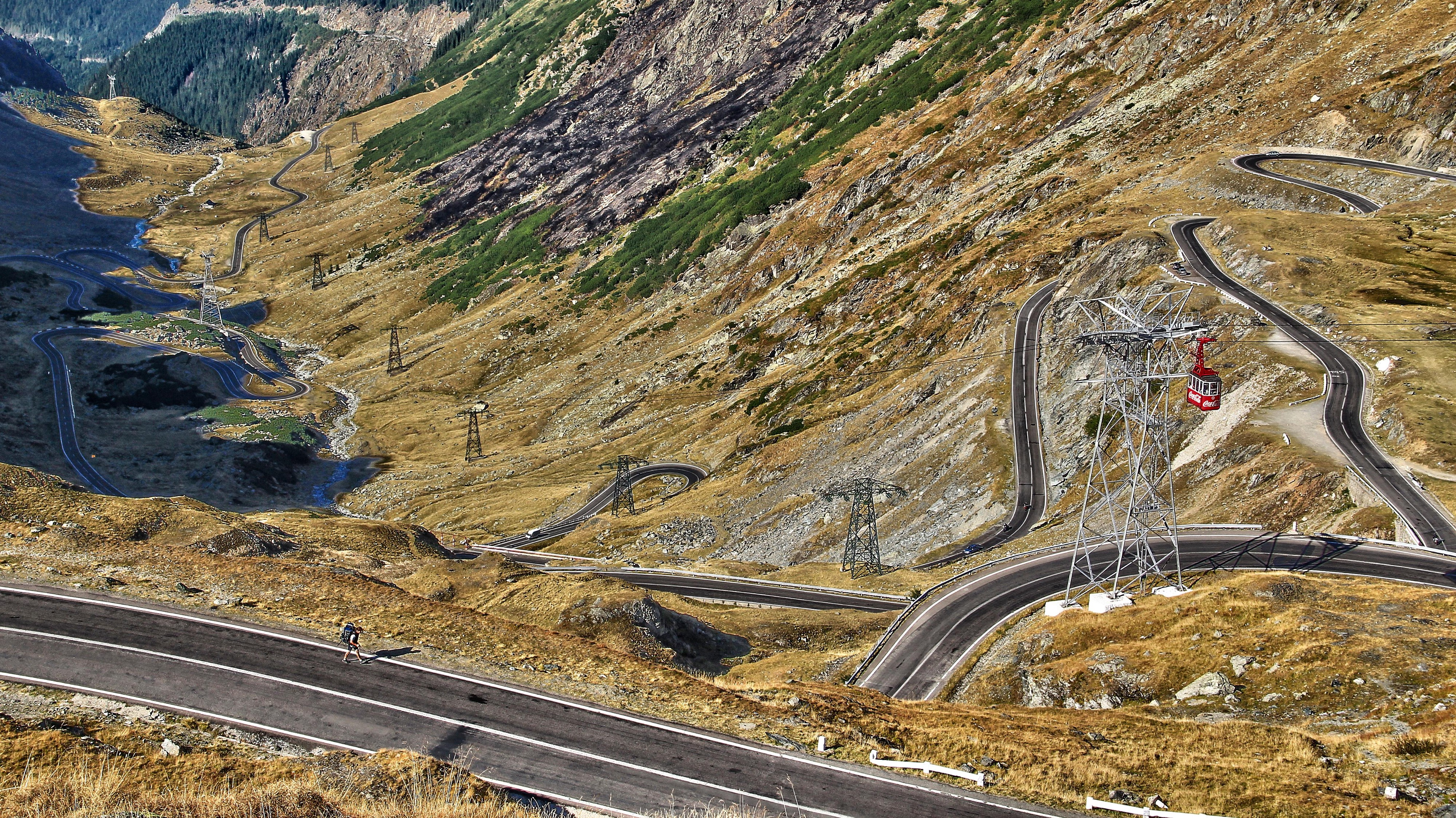 The Transfagarasan road in Romania has many tight curves & winds up a mountain. It gives stunning views & a challenging drive
