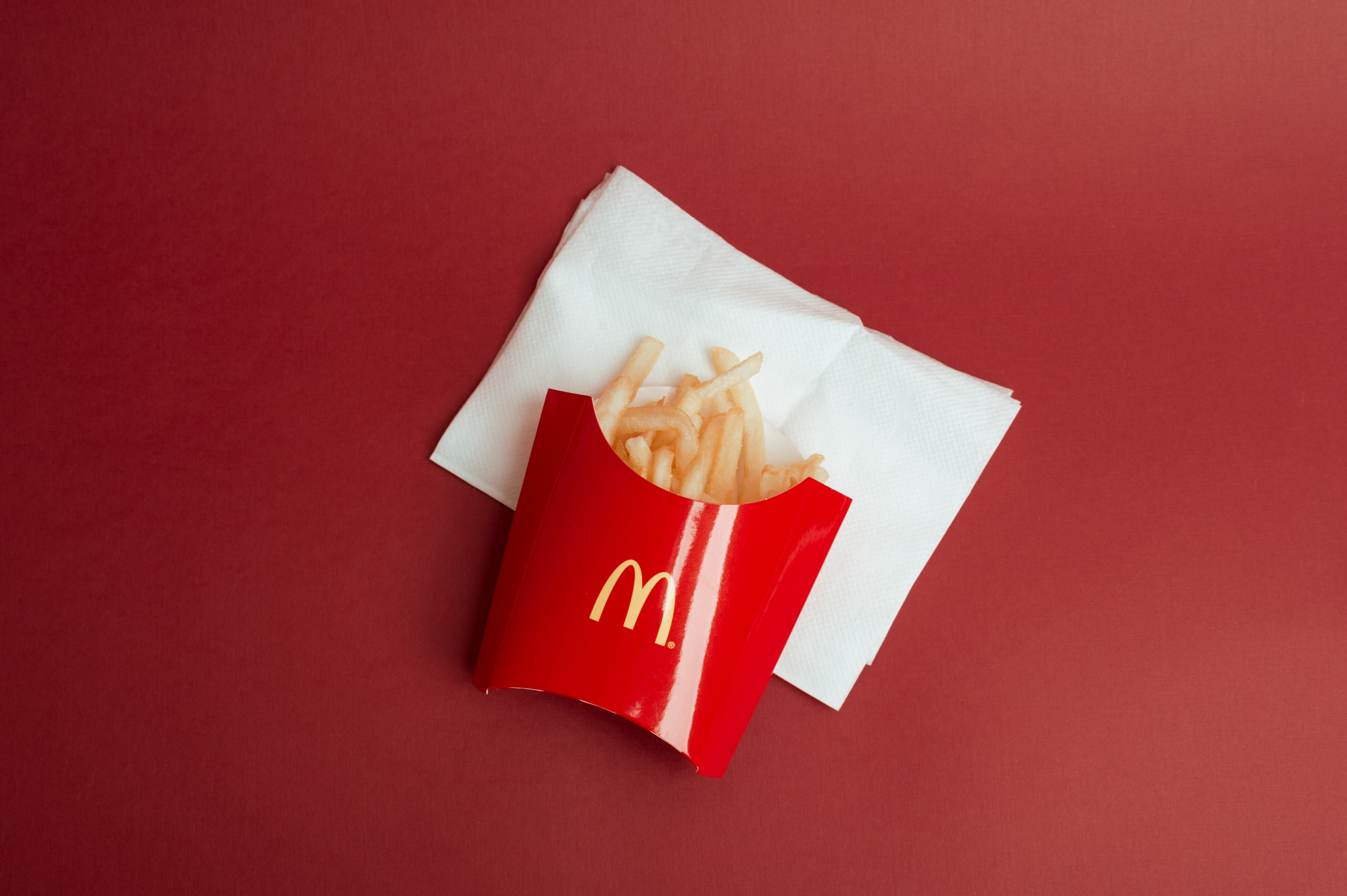 McDonald's french fries on a red table