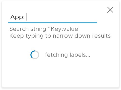 """A screenshot of the loading text """"fetching labels"""" shown when users filter by labels in the container volume datagrid view"""