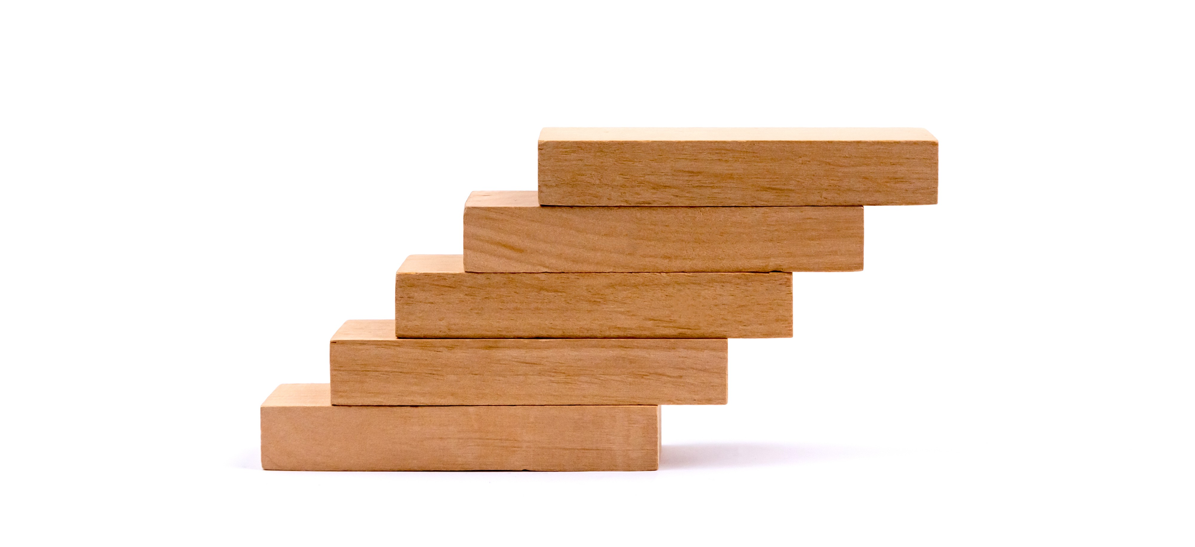 A series of wooden blocks stacked like stairs on an angle.