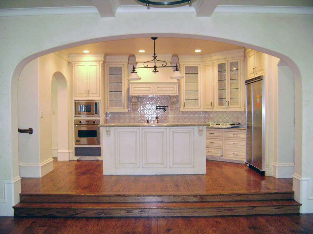Radius Arches lead into an open French country kitchen