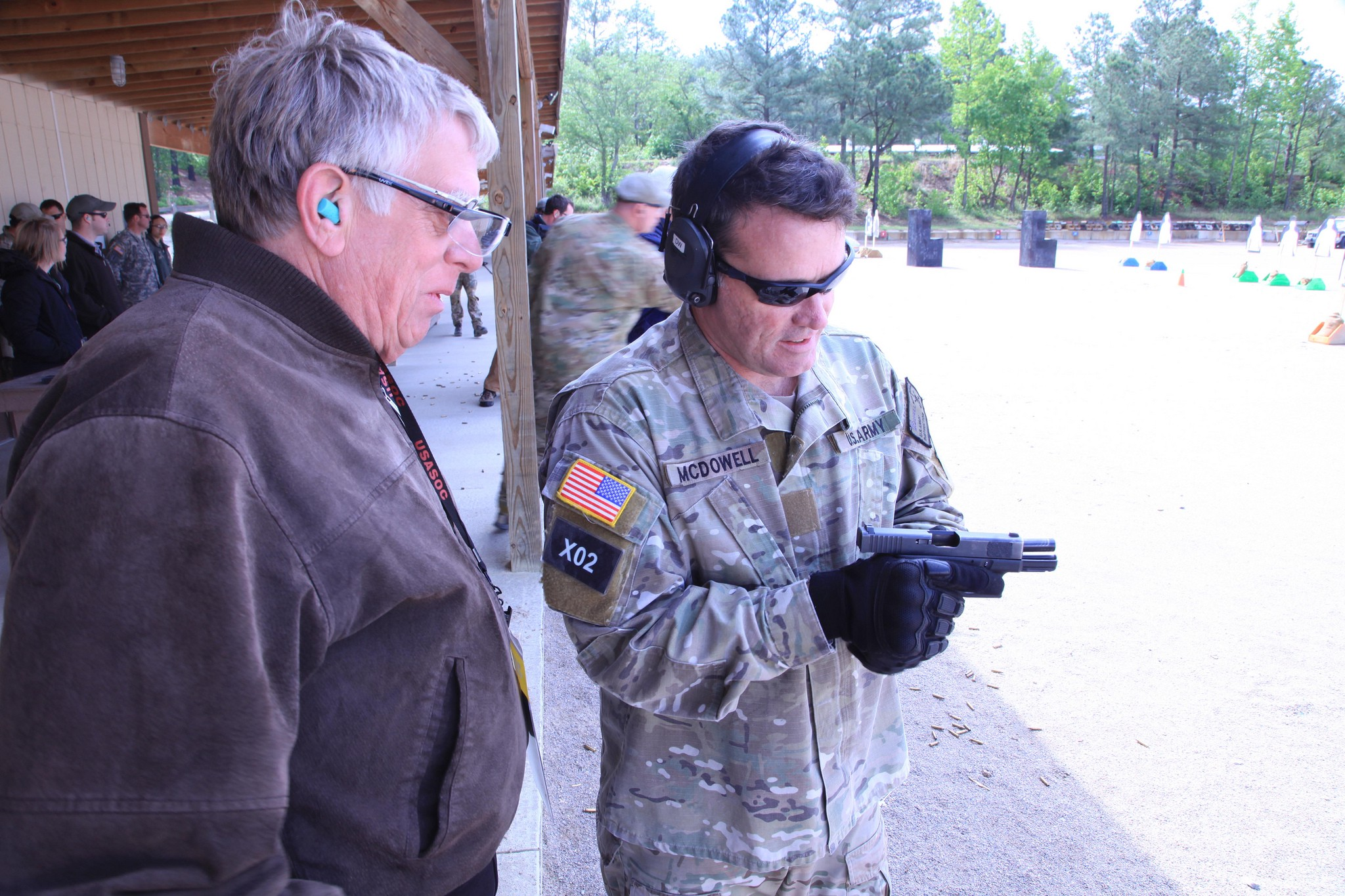An Army special forces soldier shows a Glock to a civilian during a capabilities demonstration in 2012. Army photo
