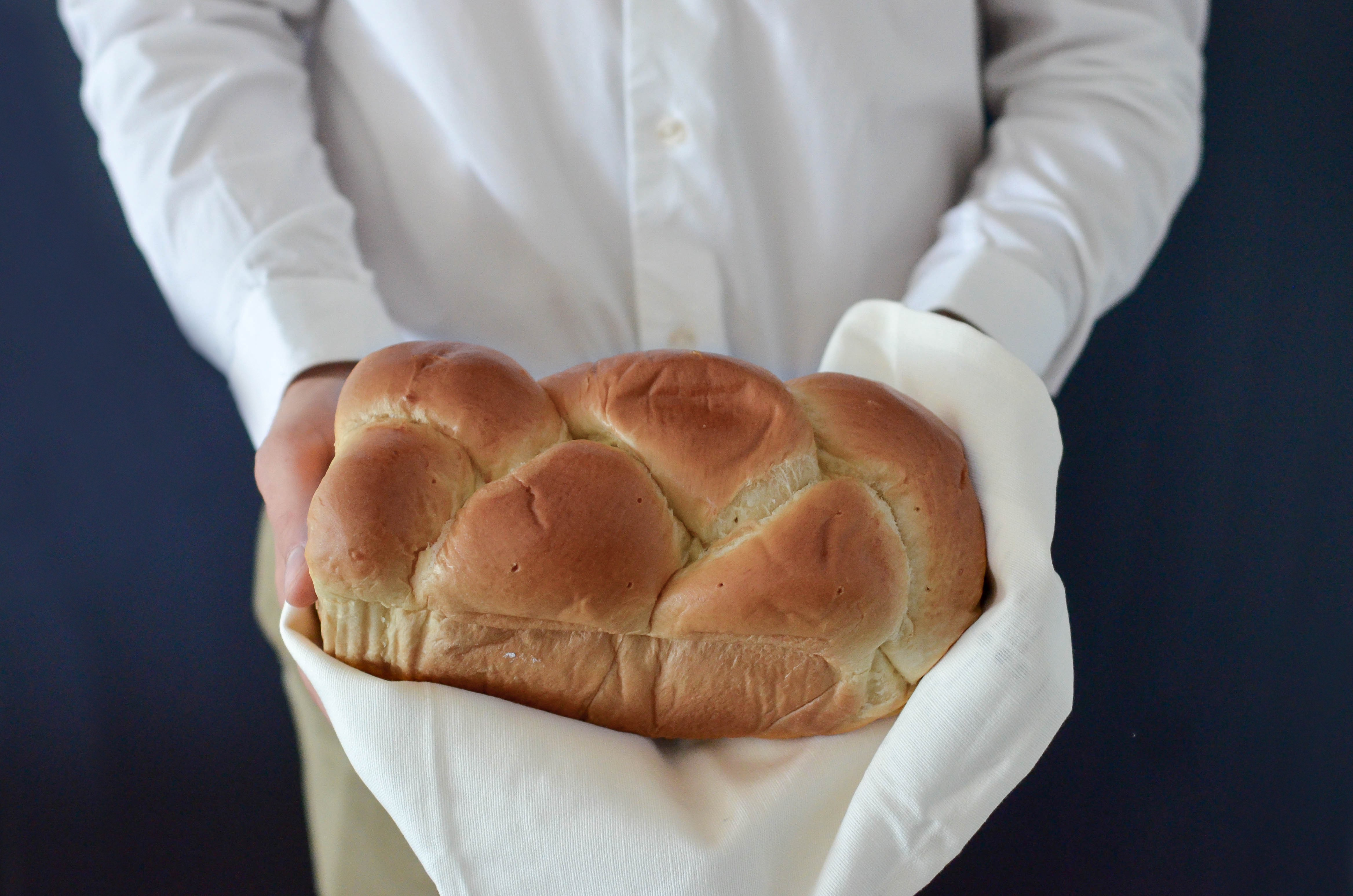 A female's hand holding a pan of fresh golden bread rolls. #Food, #Memories