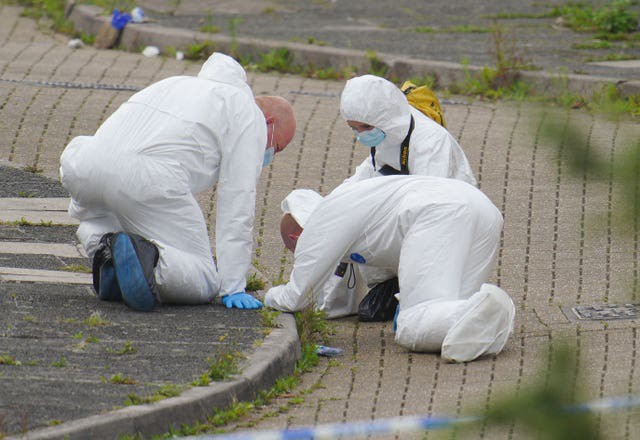 Forensic officers working at the scene on Friday (Ben Birchall/PA)