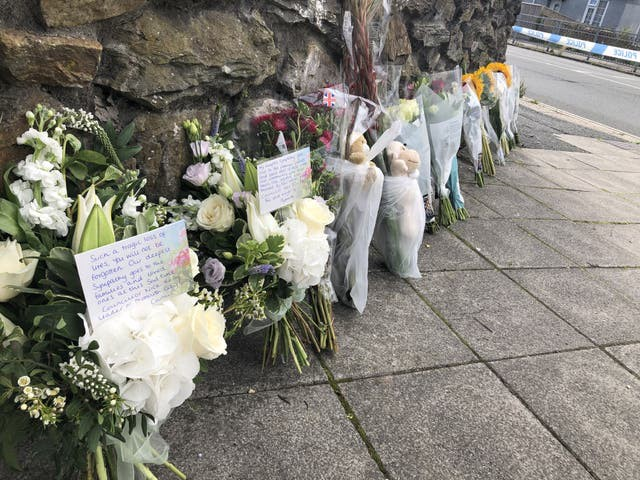 Tributes have been left near the scene (Rod Minchin/PA)