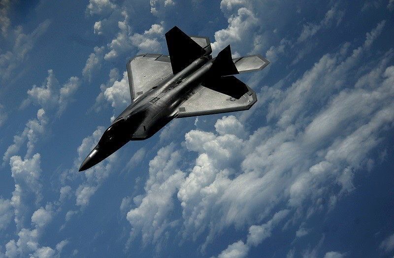 A 1st Fighter Wing's F-22 Raptor from Joint Base Langley-Eustis, Va., pulls away from a KC-135 Stratotanker with the 756th Air Refueling Squadron, Joint Base Andrews Naval Air Facility, Md., after refueling off the east coast, July 10, 2012. The first Raptor assigned to the Wing arrived, Jan. 7, 2005. This aircraft was allocated as a trainer, and was docked in a hanger for maintenance personnel to familiarize themselves with its complex systems. The second Raptor, designated for flying operations, arrived, Jan. 18, 2005. On Dec. 15, 2005, Air Combat Command commander, along with the 1st FW commander, announced the 27th Fighter Squadron as fully operational capable to fly, fight and win with the F-22.