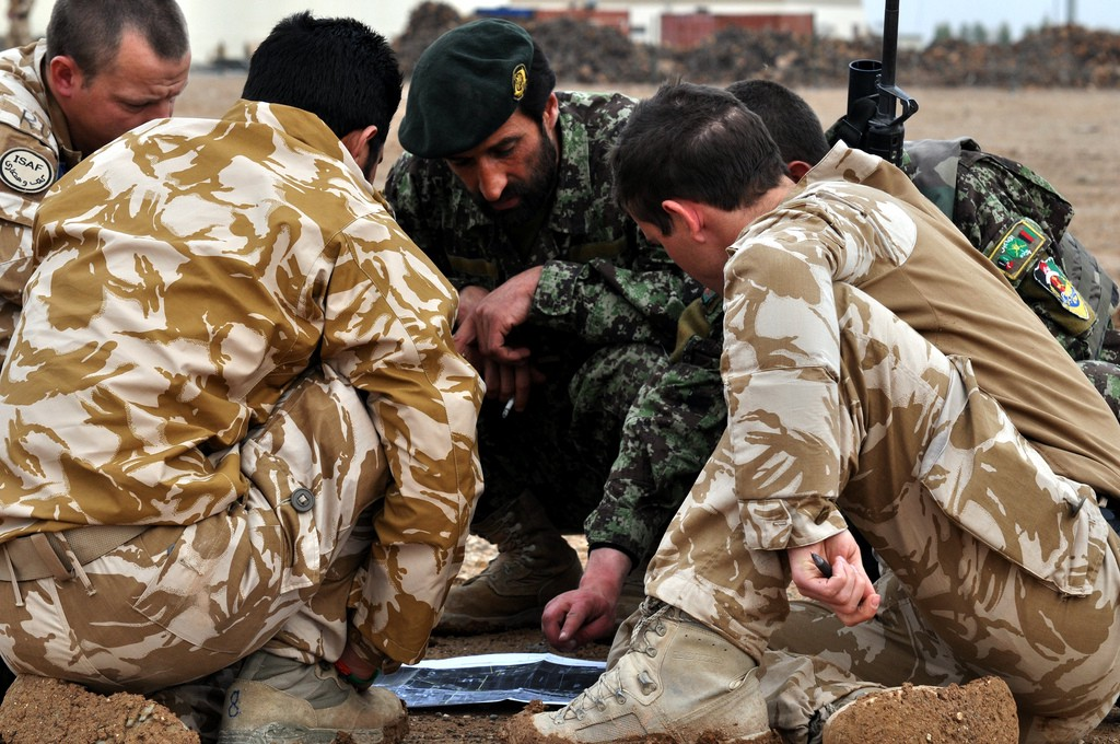 British troops in Helmand Province plan an operation with Afghan troops through an interpreter. MOD photo