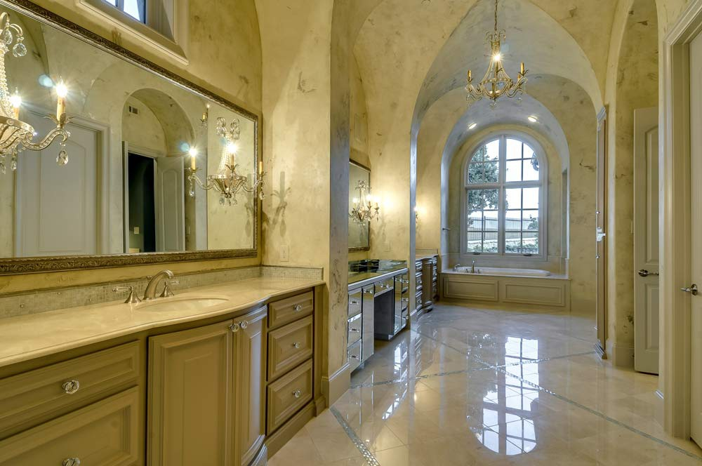 French Country Bathroom with Groin Vaults and Arched Windows
