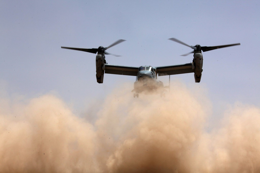 """An MV-22B Osprey lands in """"brown out"""" conditions. Marine Corps photo"""