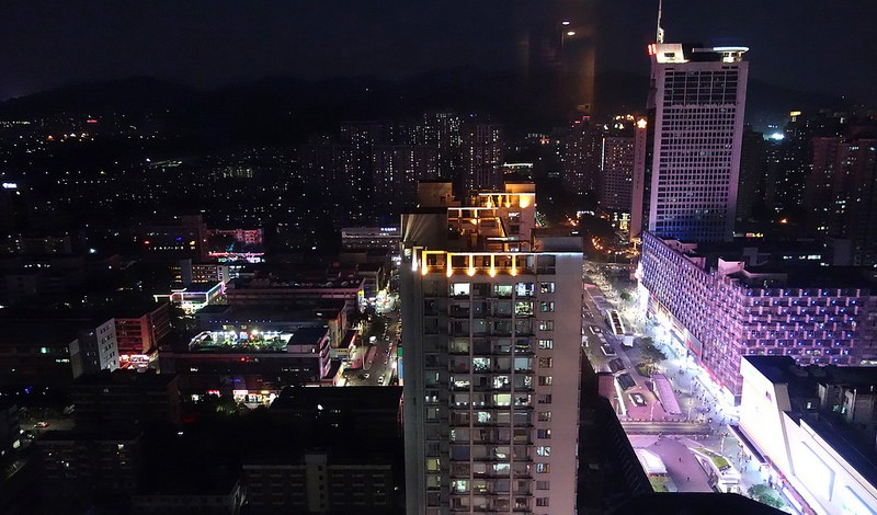 Huaqiangbei at night as seen from Huaqiang Plaza Hotel. Inside the market, shop keepers are busy restocking their inventory after a long day of tranding. Image: Peter Bihr (CC by-nc-sa)