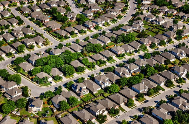 In American suburbia there are large tracts of identical houses, creating segregation based on income.