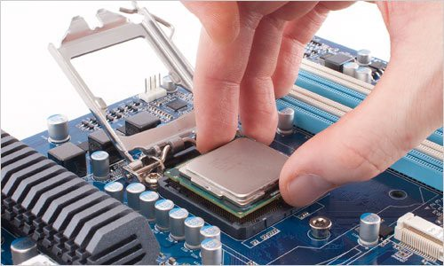 A microprocessor being slotted into its socket on a PC motherboard.