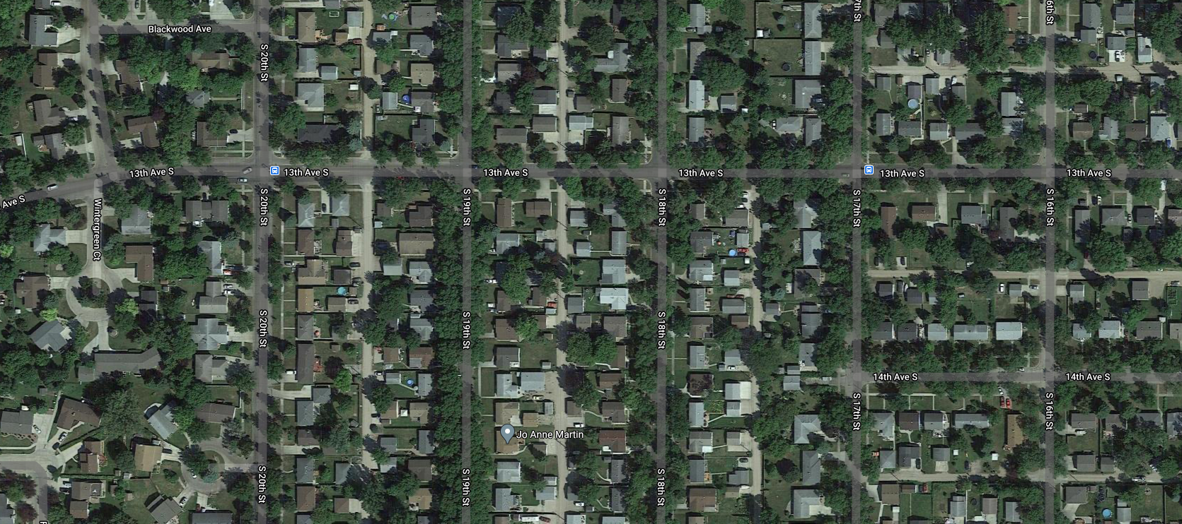 The American suburb has a lot of green space but it is all private backyards. There are no public areas.