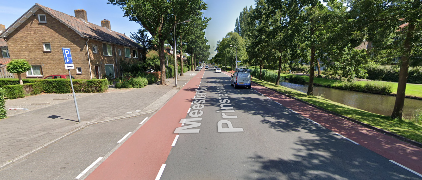 Main road in a suburb featuring bike lanes and the always present canals.